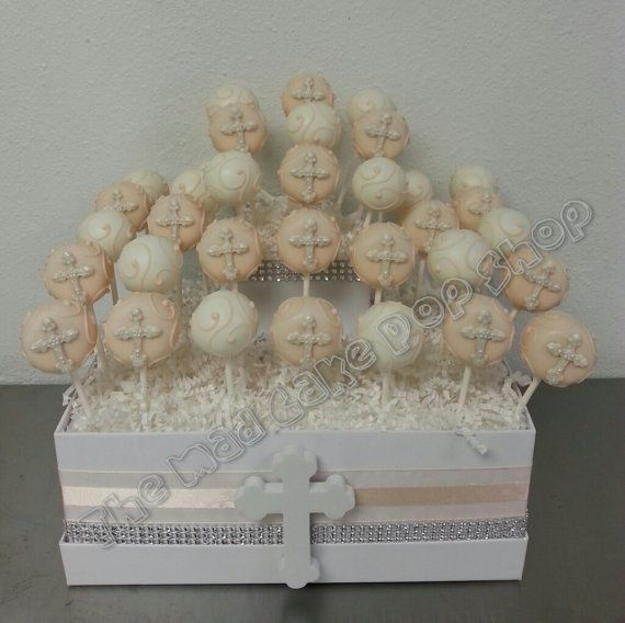 Presenting 1 dozen (12) of our adorable Cross and swirl cake pops. These are lavender and white, however, we can make any color you would like. These make a gorgeous display at a babys baptism or christening, or a first communion! Each one is hand crafted with a lot of love to help make your special day extra special. Since each pop is hand crafted there may be slight variations, but know that each one will be unique and beautiful.  This listing is for one dozen cake pops and does NOT…
