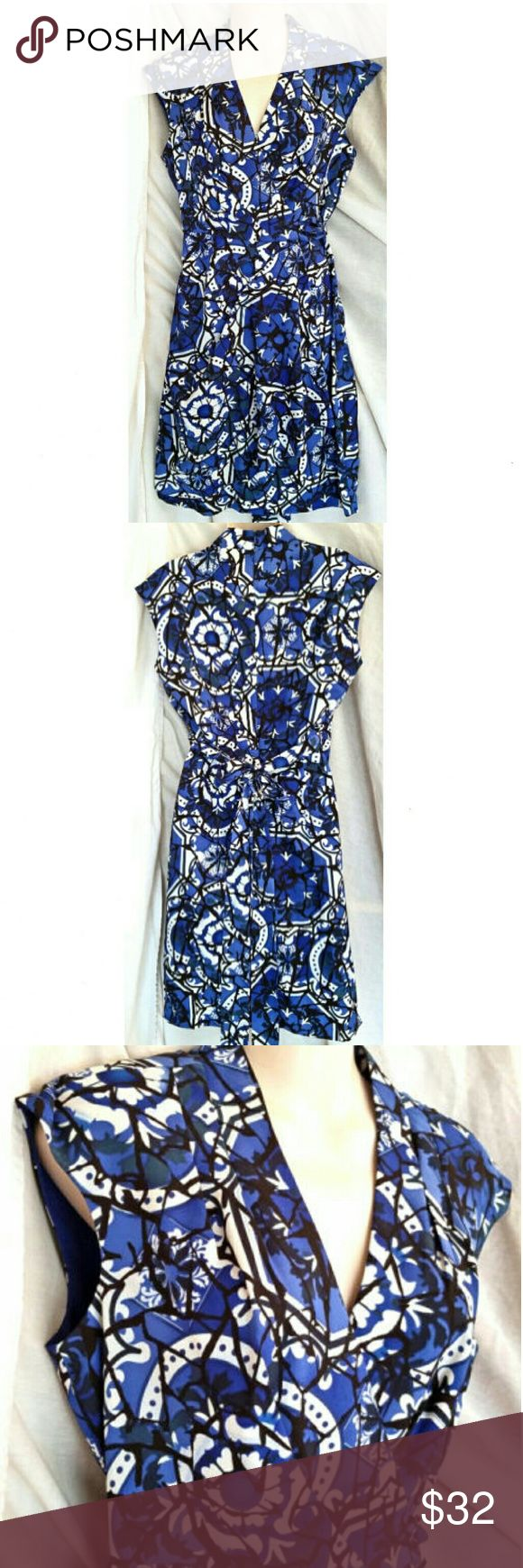 "Donna Ricco N.Y. Blue Dress Size 8 Made by Donna Ricco N.Y. Size: 8  96% polyester, 4% spandex bodice 94% polyester, 6% spandex Tie gives the appearance of a wrap dress but it actually zips up the back  Measurements are approximate and un-stretched  Length 39"" Chest 36"" Waist 28"" Hips 40"" Donna Ricco Dresses"