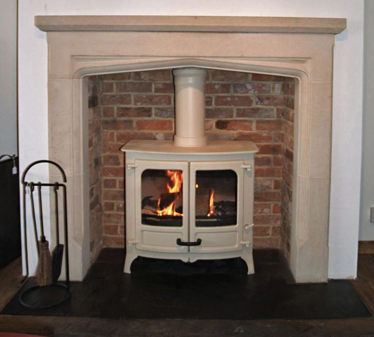 English hand carved Limestone Mantel with reclaimed brick slip chamber, natural slate tiled hearth and charnwood Island 3 multi fuel stove, ...