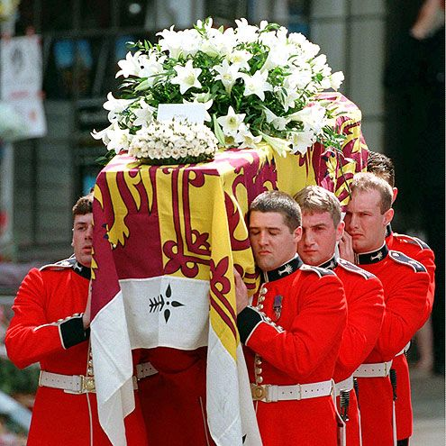 """A Sad Goodbye. More than a million people lined the streets on Sept. 6, 1997, as Diana's casket made the four-mile-long journey from London's Westminster Abbey to the Spencer family home in Northamptonshire. A card addressed to """"Mummy"""" from Harry, then 12, rested among the flowers."""