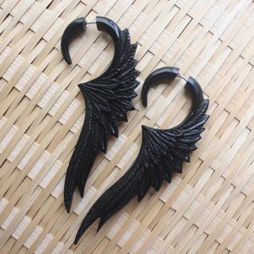 Long stunning wing earrings hand carved from natural salvaged black horn. The attention to detail is particularly evident in the fine carving of