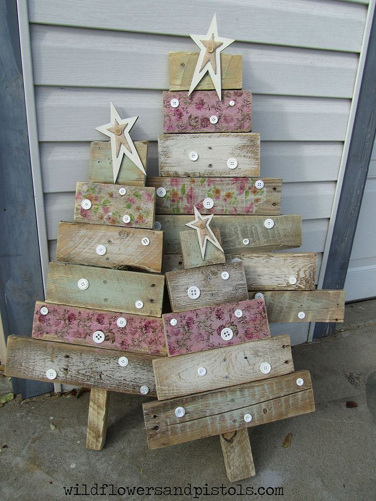 The weathered-looking patterns on each tier of theses tree are made possible with Mod Podge and decorative napkins (so clever!).   Get the tutorial at Wildflowers & Pistols »    - CountryLiving.com