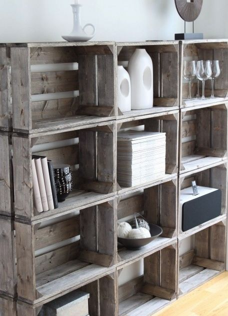 Distressed milk crates make for a unique bookshelf