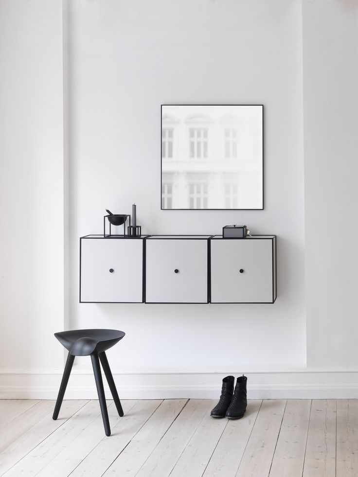 By Lassen Danish and Scandinavian style floating Bookshelf and Bookcase. Great for storage space! Also in this image is the By Lassen Bar Stool.