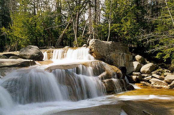 Diana's Baths, Bartlett, New Hampshire-Once the location of a sawmill operation and now a protected historical site in the White Mountain Nat'l Forest, the Diana's Baths swimming hole is best on a warm, full-moon night. Locals say it's the most romantic spot in Mt. Washington Valley. By day, the cascading falls and pools, waterspouts, and granite basins are a family favorite. An easy half-mile trail leads from the parking area to Diana's Baths just past Echo Lake State Park near North…