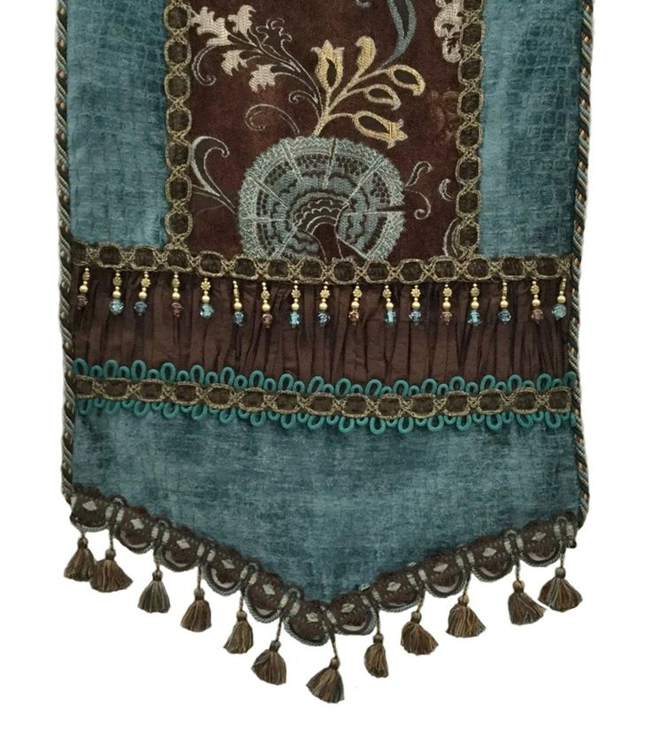 Turquoise and brown look so good together! This chenille runner is a testament to that. The chenille and faux silk table runner is topped off with both beads and tassel fringe.