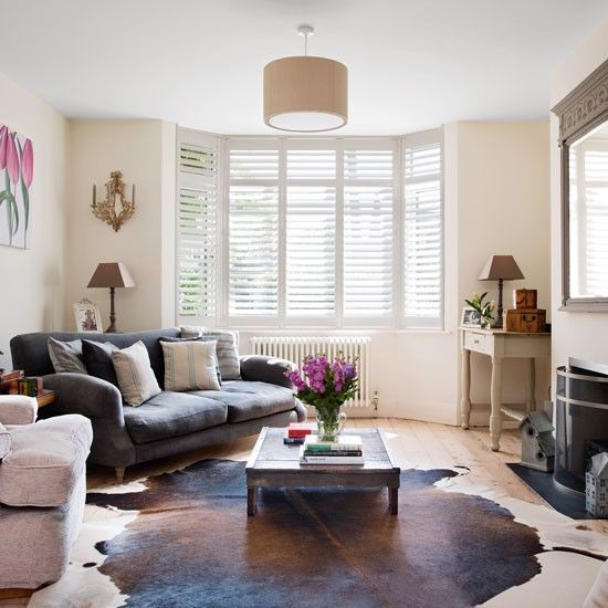 Modern living room in toning neturals and hits of pink | housetohome.co.uk
