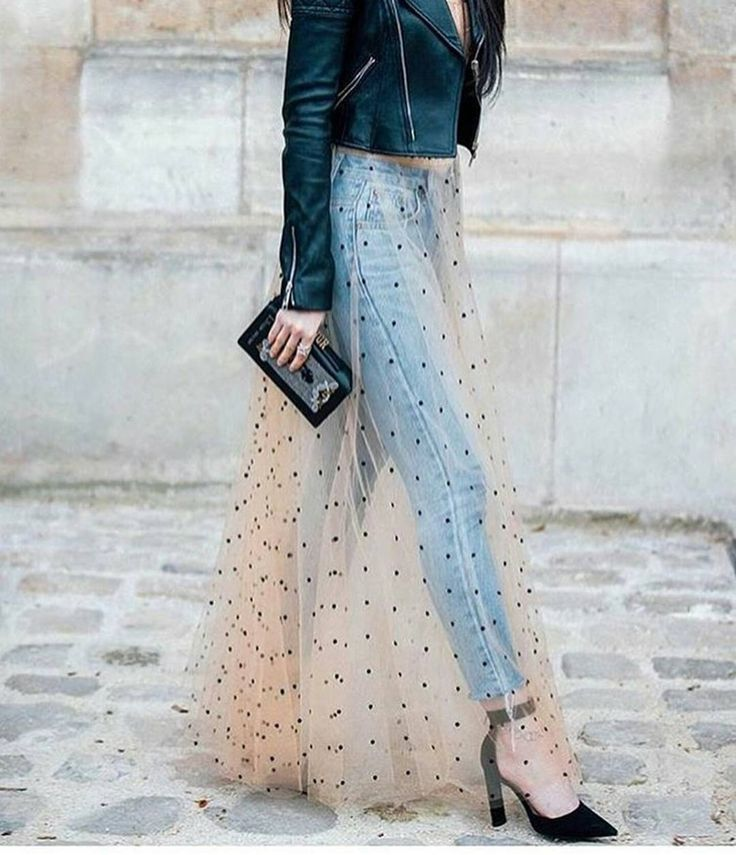 Love this stylish way to wear a sheer skirt over denim. Very chic.