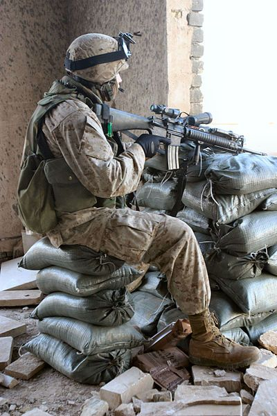 2/5 Marine stands watch in Ramadi, Iraq in February 2005