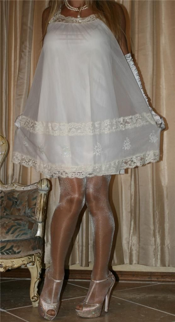 White Babydoll With Sheer Chiffon Overlay White Satin Gloves Sheer Shimmer Pantyhose and Gold Ankle Strap High Heels