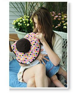 A hat for baby that doubles as a nursing cover for mom.  That's a great idea :)