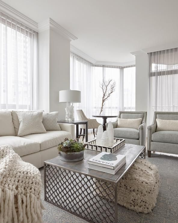 Light Themed Transitional Living Room Cozies Up With An Ivory Sofa Paired With Gray Accent Chairs Living Room Themes Living Room Grey Transitional Living Rooms