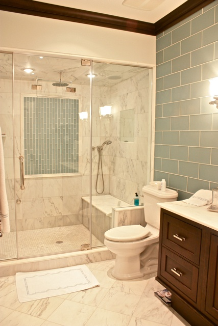 love this shower with the built in bench and seamless glass enclosure. Not sure about the marble or the tile work on the back. Maybe a little too much for my taste. The lights in the shower are cool too.