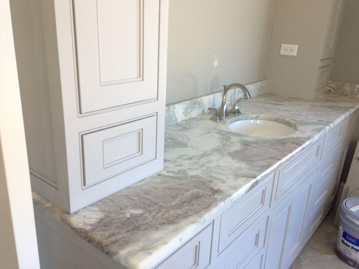 This Ocean White Quartzite Countertop Provides The Elegant Look Of Marble  In This Bathroom, Yet