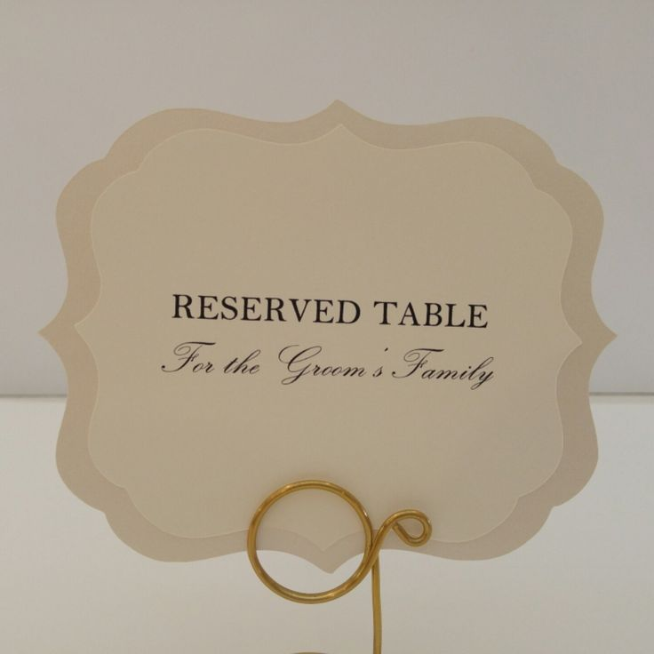 #wedding table signs to reserve tables for the bride and groom's family during the wedding reception. Colors are shimmery cream with matte cream top card stock and black font. Elegant.