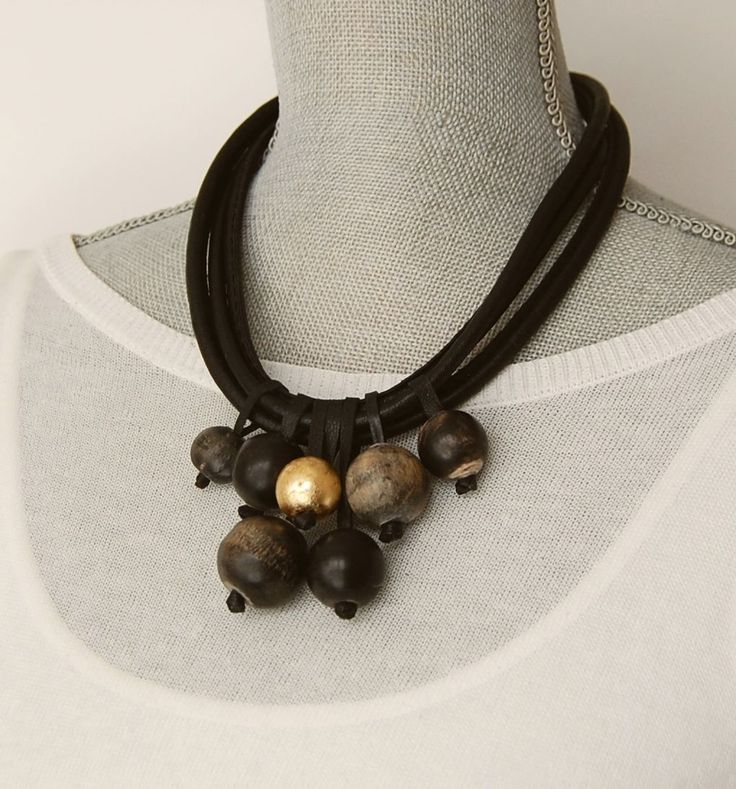 Edgy necklace - several chunky horn baubles on the thick black cord Avant-garde…
