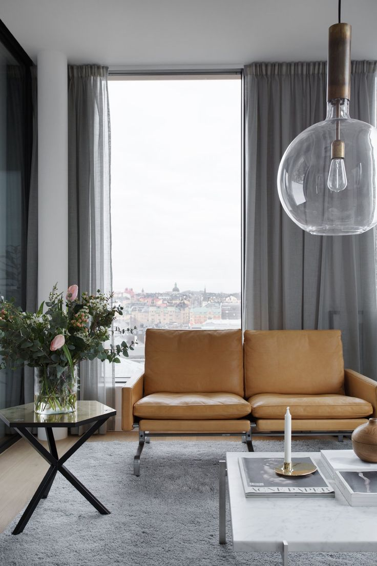 Continental apartment in grey and cognac