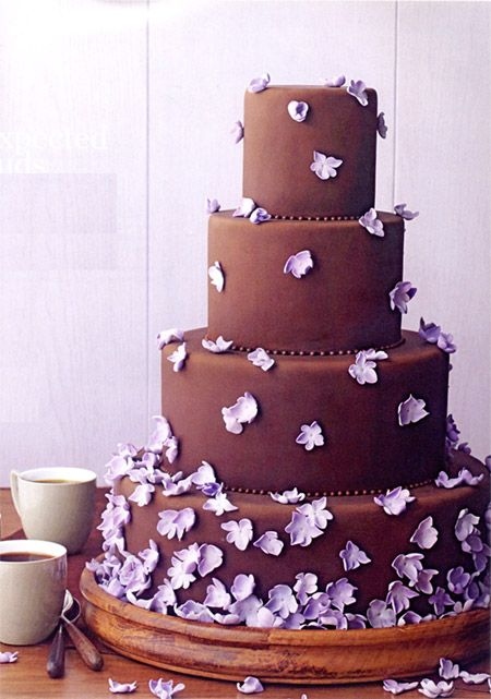 Brown cake with purple flowers. Could be done with a darker purple.