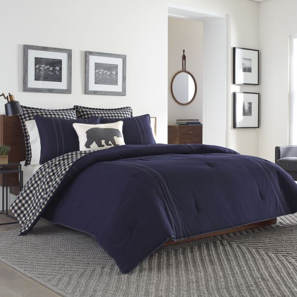 The Kingston comforter set is inspired by the classic design and construction of Eddie Bauer menswear. Featuring an attractive solid indigo cotton twill design with contrasting double-needle topstitch