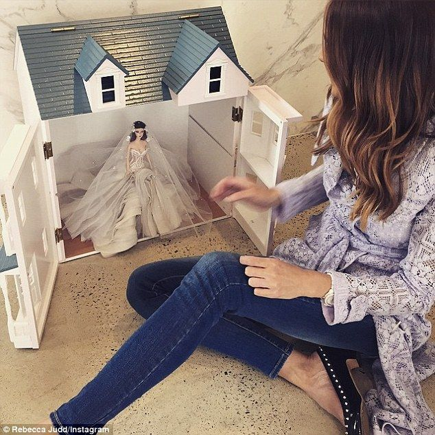 What a little princess! The mother of two's daughter Billie was lavished with first birthday swag including J'Aton couture dollhouse with a replica of her mummy in her wedding dress