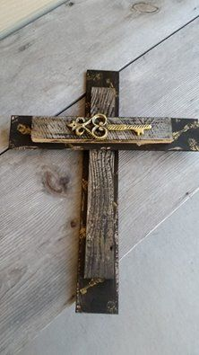 Made from scrap luan with old wood fencing...stamped on the black with gold keys..