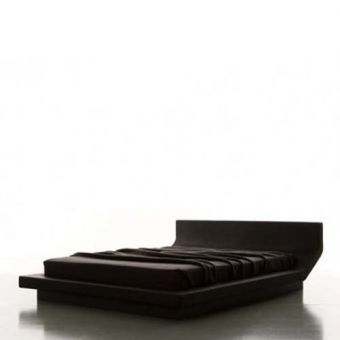 Lipla bed by Jean Marie Massaud. There is a synthetic element to the Lipla bed. The bent headboard fuses into the frame, creating a continuous form. The elastic upholstering serves to highlight the comfortable function of the bed and its sleek form gives it a unique style.