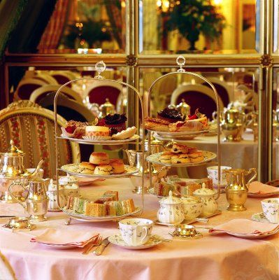 The Palm Court, London Ritz Carlton for afternoon tea or high tea -- I'd love to get all dressed up with friends and come here! :)