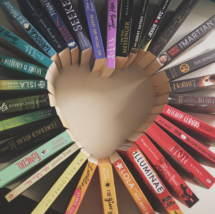 Gradient book covers arranged in a heart shape