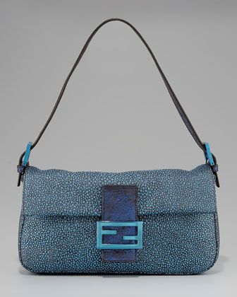 868b1a303a97 I love that the old style Fendi Baguettes are coming back! Start crackin   them out!