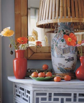 Orange and Blue - tangerine! Mary McDonald, upside down rattan wastebasket lampshade, great idea! the tangerine vases.