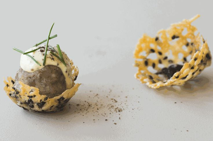 Swedish meatballs. These beef and pork meatballs, drizzled with a dollop of mustard sauce and nestled in cheese baskets, make a tasty and stylish canape to serve with drinks.