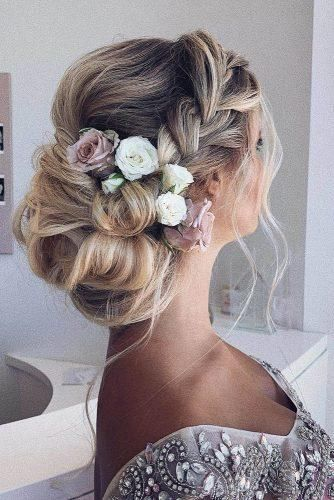 wedding hairstyles medium hair volume low bun with flowers and loose curls anahhair #weddinghairstyles