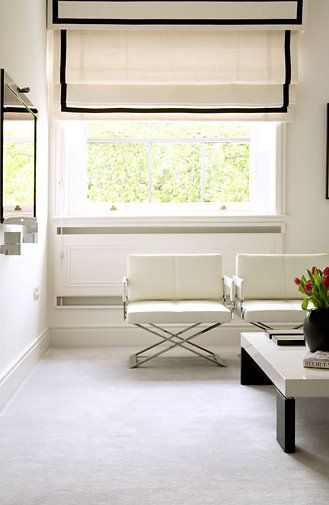 Carrying the black and white linear effect through the roman blinds makes a stunning design statement. #romanblinds #interiordesign