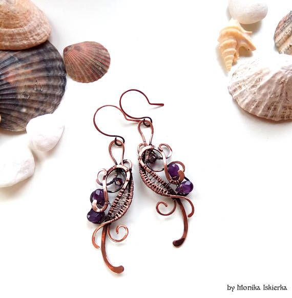 Neala II- wire wrapped earrings with purple, violet amethyst. Oxidized/tinted, hammered and polished copper wire for ancient, old looking, vintage effect. Size is about 8,5 x 2 cm with hooks.  100% handmade. Made by Monika Iskierka.