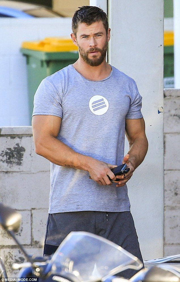Muscly man: The 32-year-old Australian actor flaunted his bulging biceps on the day ...