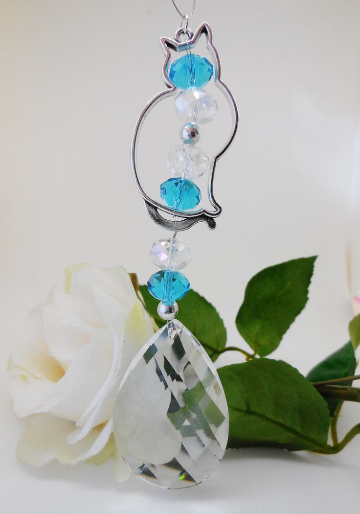 Sun-CAT-Cher, Silver plated Seated Cat with sparkling faceted clear & teal glass beads and faceted glass teardrop pendant. Non perishable wire loop for hanging in car or window.