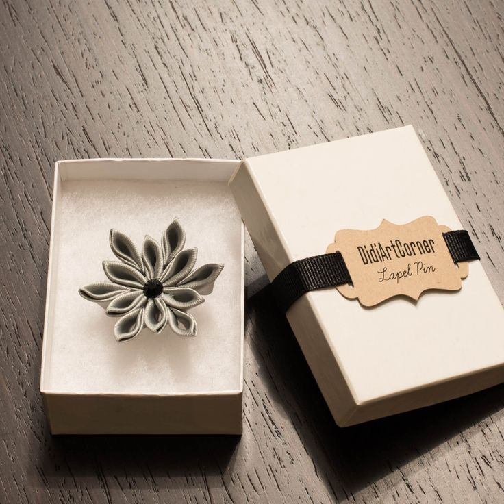 A personal favorite from my Etsy shop https://www.etsy.com/listing/456053322/gray-satin-poinsettia-flower-lapel-pin