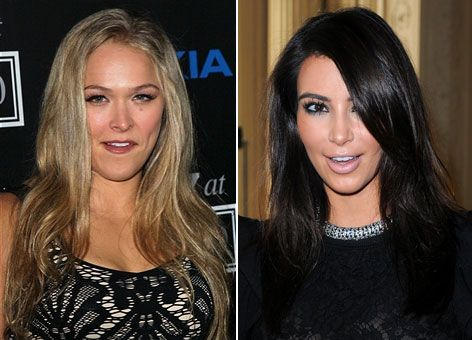 MMA bantam weight champ and ESPN Magazine body issue cover girl Ronda Rousey is not a fan of Kim Kardashian and says she'd beat the reality star up given the chance.