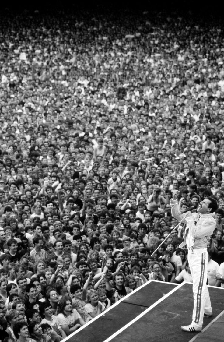 Freddie Mercury commands at Wembley Stadium; One of the greatest moments in music history, imo. Makes this sensative girl cry.