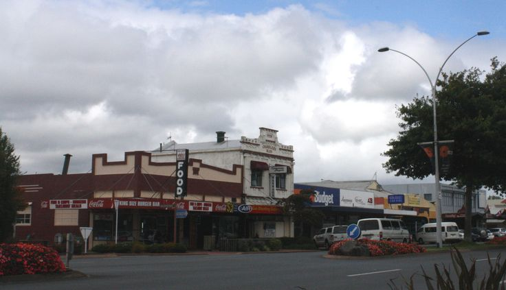 "Fenton Street 2012 showing two heritage buildings.   ""One of the earliest surviving commercial buildings and was the most substantial when built in 1920 and is built of pumice concrete. It has associations with the Chandler family. George Chandler was a prominent businessman in the earlier decades of Rotorua township's development. Mary Kate Chandler also built the adjacent Grosvenor Flats, Beale's Grocery and Beale's Garage."" from Rotorua CBD Built Heritage Study"