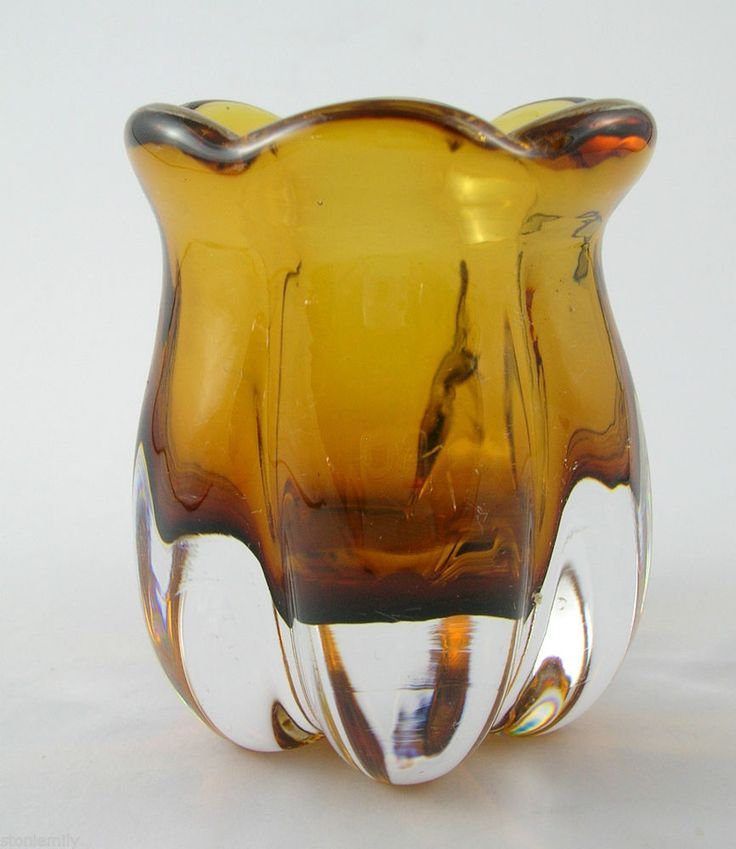 From our eBay site 'Em's Eclectic Emporium'- This little gem is by Elis Bergh and dates to c1940. Signed B2565 to the base, it features a deep amber glass cased within thick clear glass. An important figure in Scandinavian glass design, Bergh was one of the first to bring the Italian 'Sommerso' technique to Scandinavia.  This little piece uses this technique of layering one coloured glass within the other. Bergh worked as the chief designer of Kosta from 1929 to 1950.