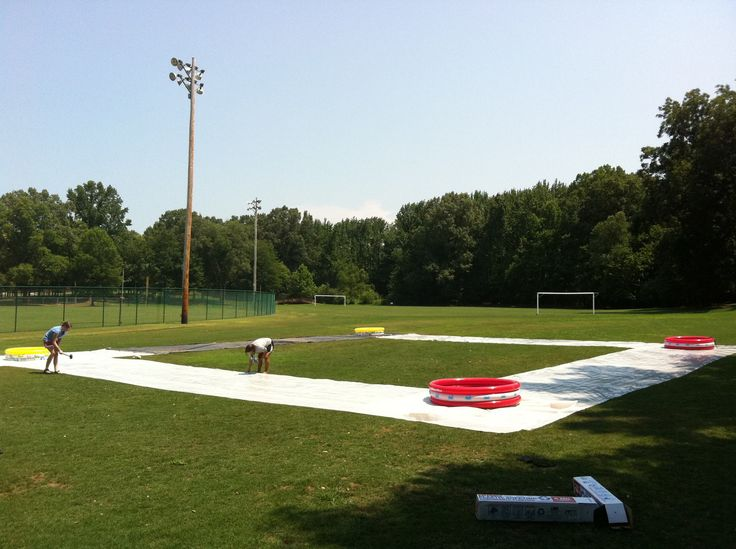 kick ball water slide -plastic strips soaped down with kiddie pools as bases