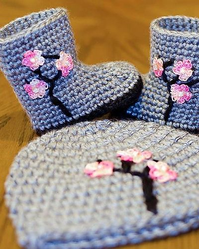 Ravelry: Cherry blossom hat and boots pattern by Sue Mercer