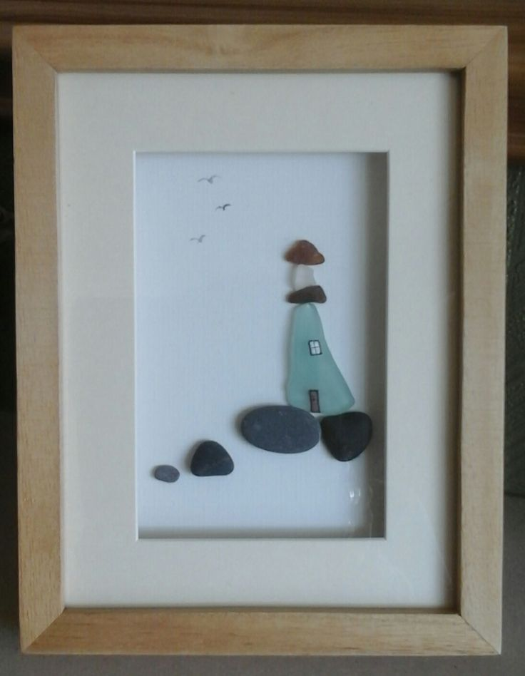Sea glass and pebbles look so great together.