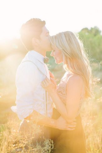 Engagement Photo Poses and Ideas - dreamy effect of a kiss on the grassland. Definitely a must.