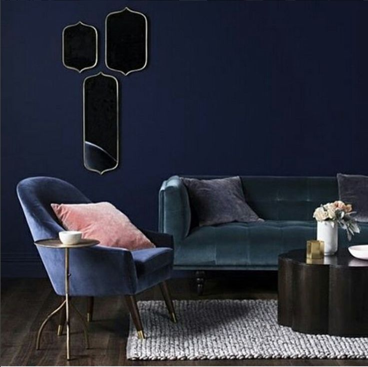 1st: the pink pillow, and by extension that blue chair and side table.  2nd: the trio of mirrors that look black 3rd: the white rug 4th: the other couch 5th: the coffee table