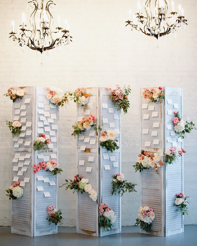 Old shutters and chandeliers created the perfect, vintage escort card display for this Chicago wedding!  #theknot #theknotillinois : @yazyjo I Design: @detroitcultivated