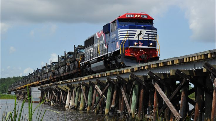 Today we salute America's military spouses who are the backbone of the families who support our troops. Happy military spouse appreciation day.    Pictured: The Veterans locomotive and a special military load cross a bridge traveling from Camp Lejeune in Jacksonville, N.C., to New Bern, N.C. www.nscorp.com