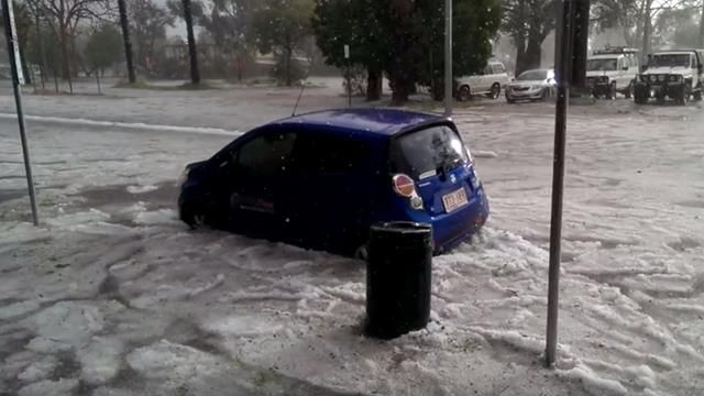 <p>A slush made of water and hail swirled down Alice Springs streets. </p> <p>(Caama Alice Springs)</p>
