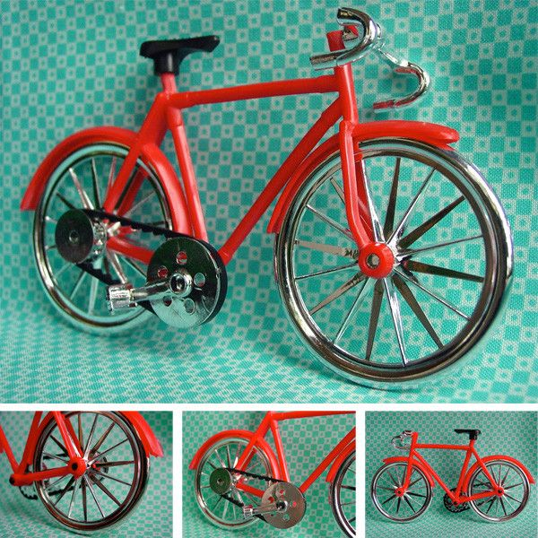 """- Red Bicycle Cake Topper - An old school red and chrome beach cruiser bicycle for topping your small to large cakes and desserts. Wheels, pedals and chain turn! - 3-1/2""""(9cm) tall x 5-3/4""""""""(14cm) lon"""